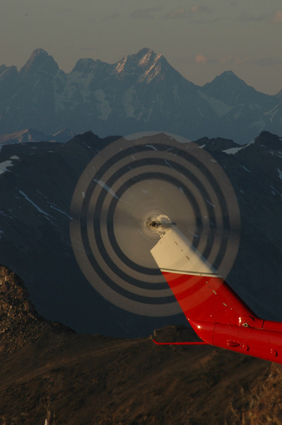 """Spinning tail rotor on top of """"Vertigo"""". The remote Goodsir Towers in the towering in the background."""