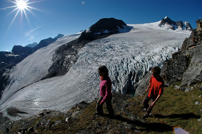 Hikers above the biggest glacier in the Purcell mountains, the Conrad Icefield.