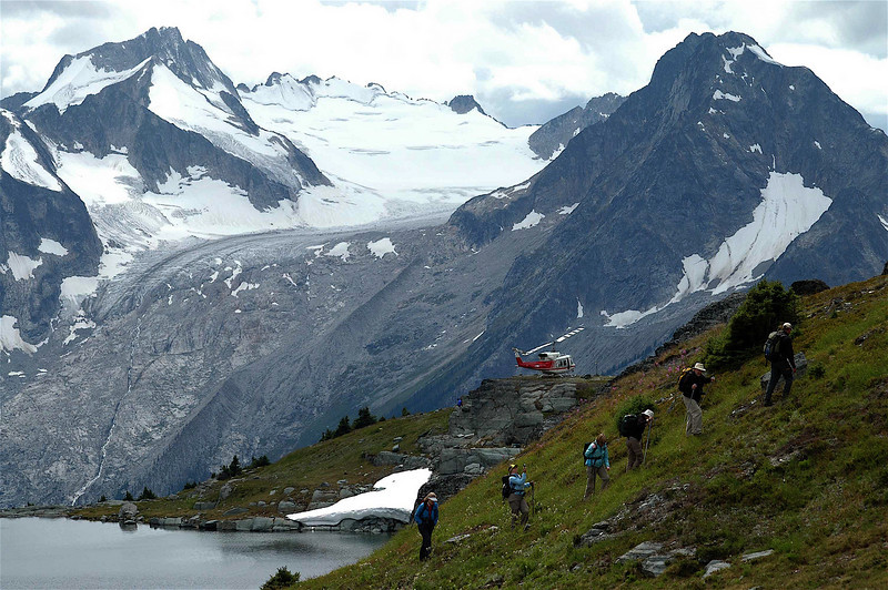 The last few steps after a long day hike in International Basin to the parked helicopter. Mt. Nautilus and Nemo Glacier behind are already part of the Selkirk Mountains