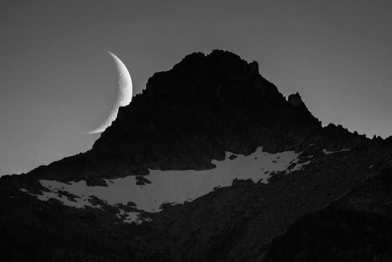 Crescent moonset over Eastpost Spire