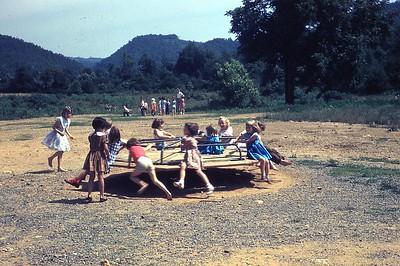 1956 DVBS Stickleyville kids on merry go round