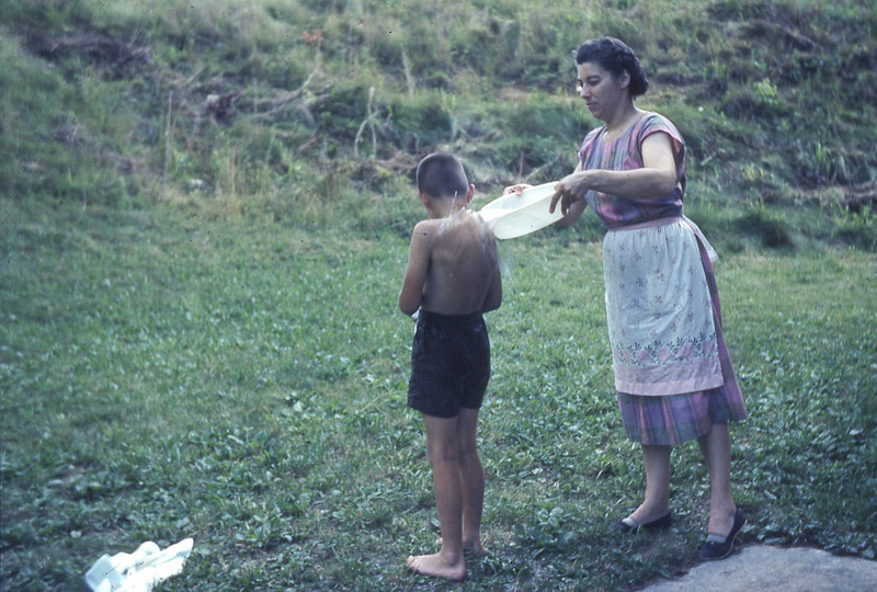 august 1961-''GERTRUDE HELPING LITTLE ARNOLD WASH UP''