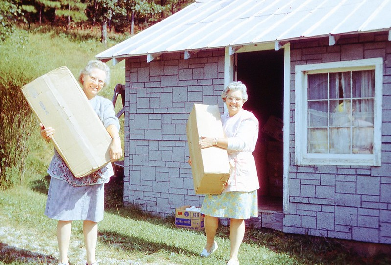 1969 - Naomi & Winnie Carrying Used Clothes