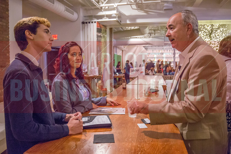 Following the panel discussion, Selim Bingol, SVP & CCO at Duke Energy, and other panelists broke out into small group discussions with attendees of Charlotte Business Journals CMO Unplugged event at 8.2.0 Bar, AvidXchange Music Factory.