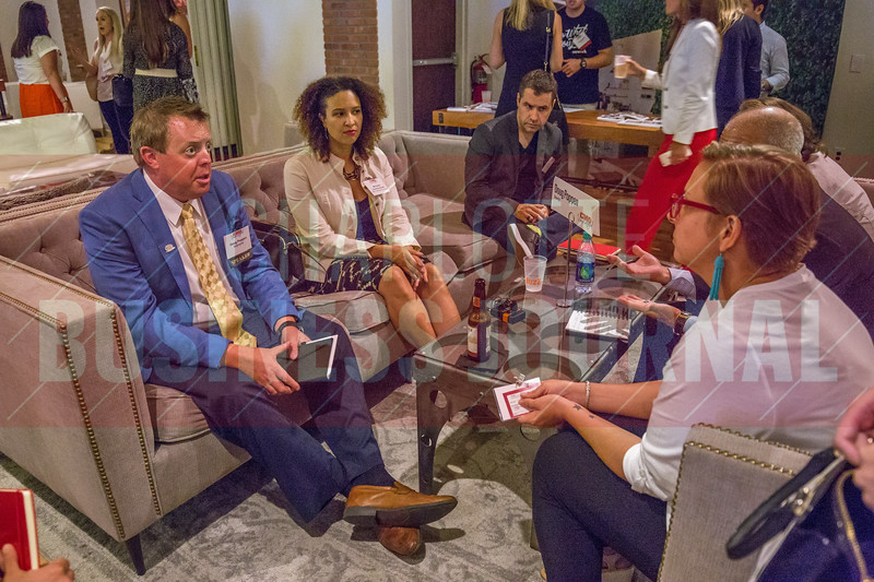 Doug Poppen, VP of Marketing and Communications at Bojangles', and other panelists broke out into small group discussions with attendees of Charlotte Business Journals CMO Unplugged event at 8.2.0 Bar, AvidXchange Music Factory.