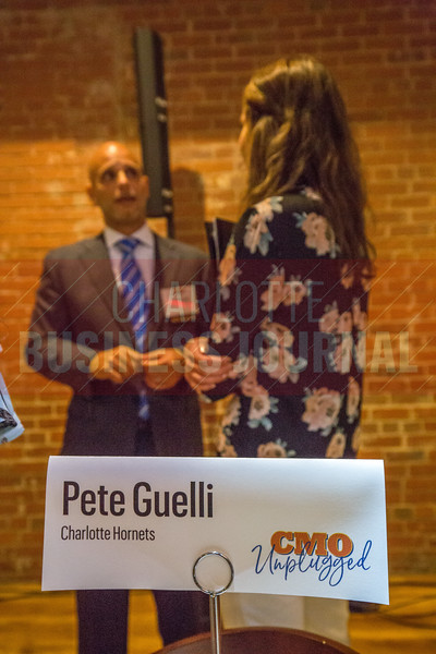 Following the panel discussion, Pete Guelli, EVP & CMO at Charlotte Hornets, and other panelists broke out into small group discussions with attendees of Charlotte Business Journals CMO Unplugged event at 8.2.0 Bar, AvidXchange Music Factory.
