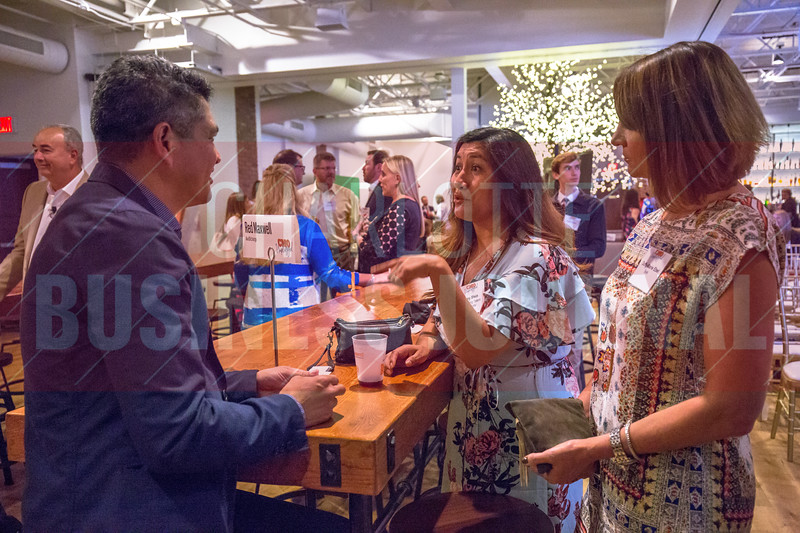 Following the panel discussion, Red Maxwell, CMO at AvidXchange (left), and other panelists broke out into small group discussions with attendees of Charlotte Business Journals CMO Unplugged event at 8.2.0 Bar, AvidXchange Music Factory.
