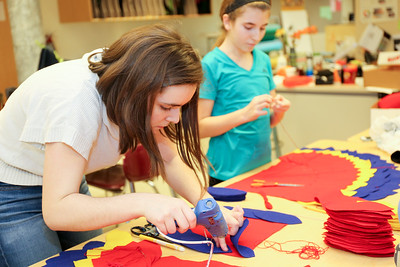 Working on costumes for Disney's Aladdin Jr. at Canton Middle chool are Ali Scott, left, and Rachel Flink.