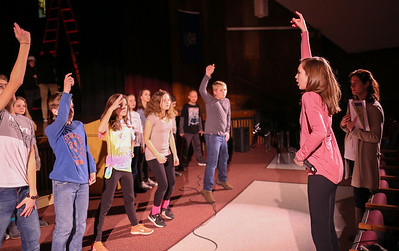 Calla Begley, a narrator for the production, helps choreograph a scene for Canton Middle School's production of Disney's Aladdin Jr. At far right is co-director Elana Chafetz.