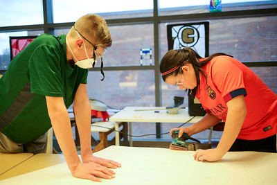 From left, Nathan Clark and Julia Lau, work on a set piece from Canton Middle School's production of Disney's Aladdin Jr.