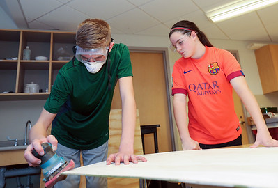 Nathan Clark and Julia Lau work on a set piece for the Aladdin Jr. production at Canton Middle School.