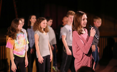Calla Begley, a narrator for the production, helps choreograph a scene for Canton Middle School's production of Disney's Aladdin Jr.