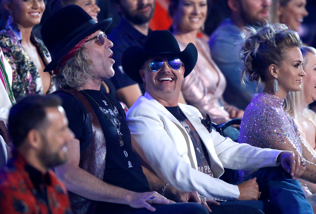 . Big Kenny, left, and John Rich, of Big & Rich and carrie Underwood, right, appear in the audience at the CMT Music Awards at Music City Center on Wednesday, June 7, 2017, in Nashville, Tenn. (Photo by Wade Payne/Invision/AP)