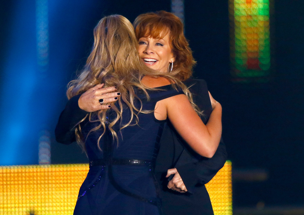 . Reba McEntire, right, congratulates Lauren Alaina after presenting her with the award for breakthrough video of the year at the CMT Music Awards at Music City Center on Wednesday, June 7, 2017, in Nashville, Tenn. (Photo by Wade Payne/Invision/AP)