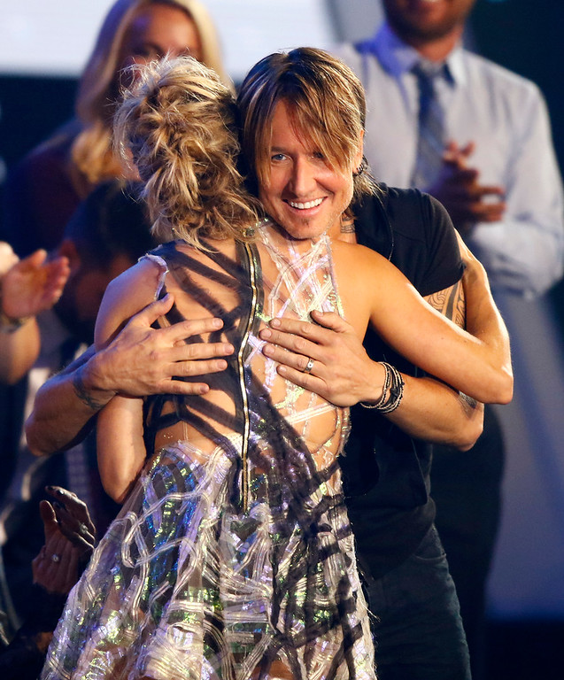 ". Carrie Underwood, left, and Keith Urban embrace after winning the award for collaborative video of the year for ""The Fighter\"" at the CMT Music Awards at Music City Center on Wednesday, June 7, 2017, in Nashville, Tenn. (Photo by Wade Payne/Invision/AP)"