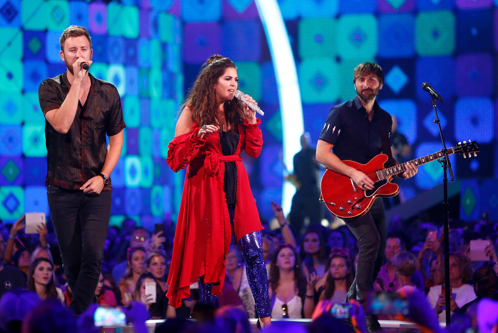 . Charles Kelley, from left, Hillary Scott and Dave Haywood, of Lady Antebellum, perform at the CMT Music Awards at Music City Center on Wednesday, June 7, 2017, in Nashville, Tenn. (Photo by Wade Payne/Invision/AP)