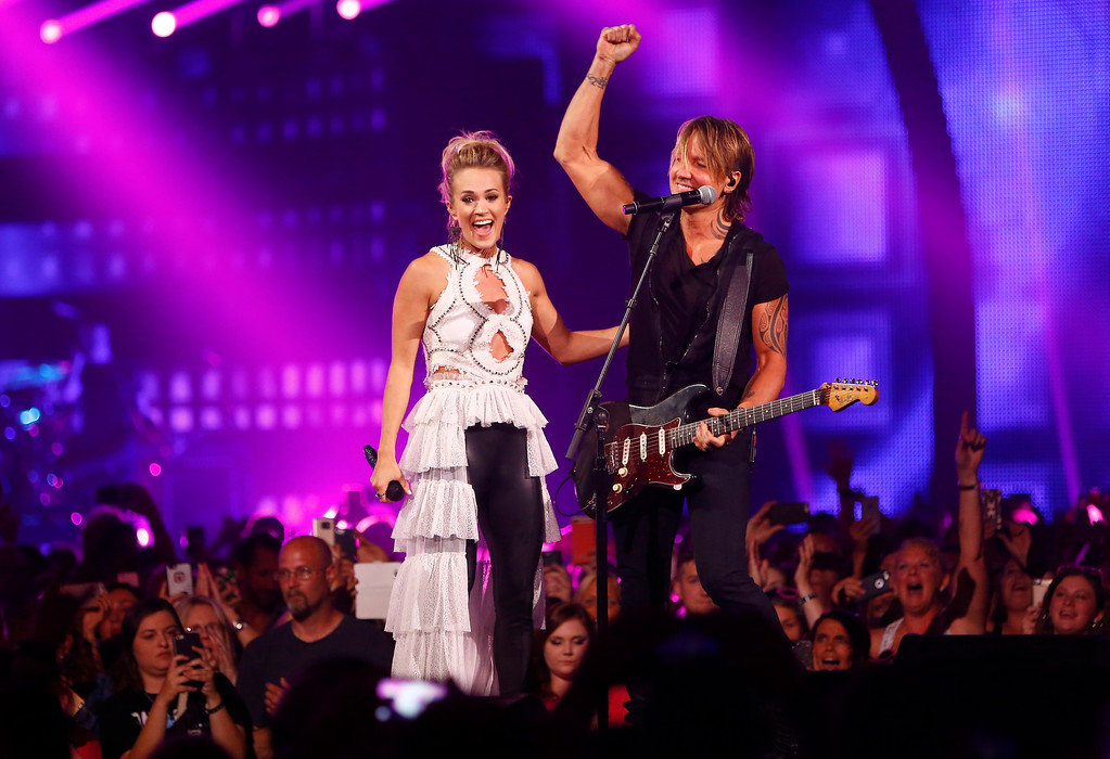 ". Carrie Underwood, left, and Keith Urban react after performing ""The Fighter\"" at the CMT Music Awards at Music City Center on Wednesday, June 7, 2017, in Nashville, Tenn. (Photo by Wade Payne/Invision/AP)"
