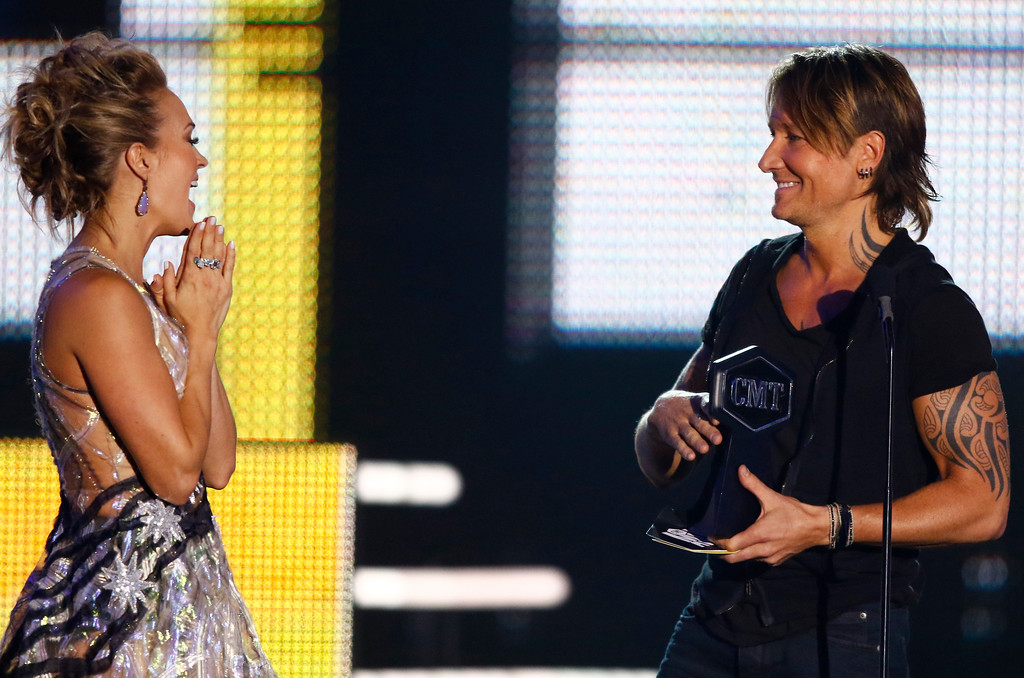 ". Carrie Underwood, left, and Keith Urban react as they accept the award for collaborative video of the year for ""The Fighter\"" at the CMT Music Awards at Music City Center on Wednesday, June 7, 2017, in Nashville, Tenn. (Photo by Wade Payne/Invision/AP)"