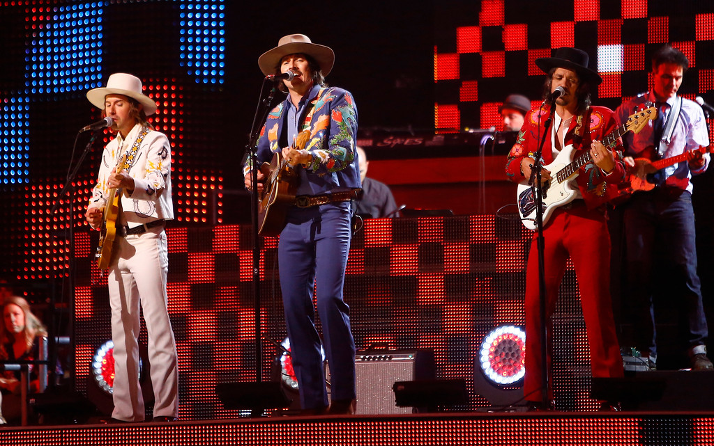 ". Jess Carson, from left, Mark Wystrach and Cameron Duddy, of Midland, perform ""Drinkin\' Problem\"" at the CMT Music Awards at Music City Center on Wednesday, June 7, 2017, in Nashville, Tenn. (Photo by Wade Payne/Invision/AP)"