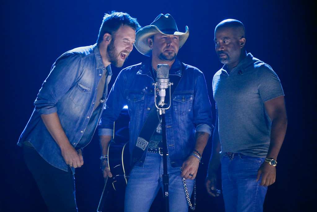". Charles Kelley, from left, Jason Aldean, and Darius Rucker perform ""Midnight Rider\"" during a tribute to Greg Allman at the CMT Music Awards at Music City Center on Wednesday, June 7, 2017, in Nashville, Tenn. (Photo by Wade Payne/Invision/AP)"