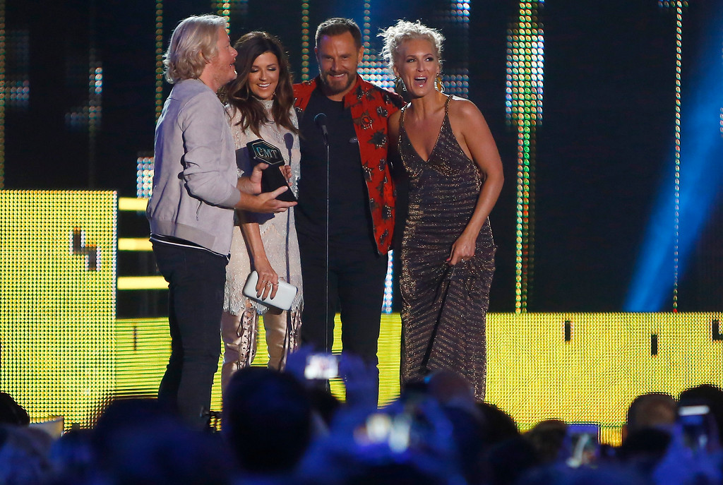 ". Philip Sweet, from left, Karen Fairchild, Jimi Westbrook and Kimberly Schlapman, of Little Big Town, accept the award for group video of the year for ""Better Man\"" at the CMT Music Awards at Music City Center on Wednesday, June 7, 2017, in Nashville, Tenn. (Photo by Wade Payne/Invision/AP)"