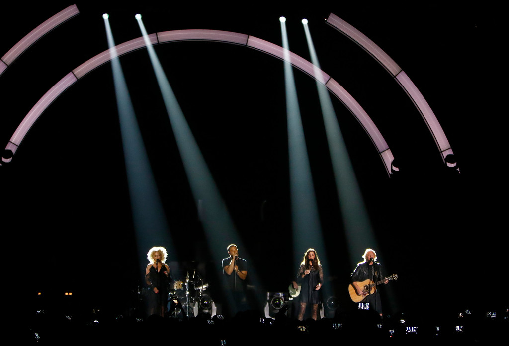 ". Kimberly Schlapman, from left, Jimi Westbrook, Karen Fairchild, and Philip Sweet, of Little Big Town, perform ""When Someone Stops Loving You\"" at the CMT Music Awards at Music City Center on Wednesday, June 7, 2017, in Nashville, Tenn. (Photo by Wade Payne/Invision/AP)"