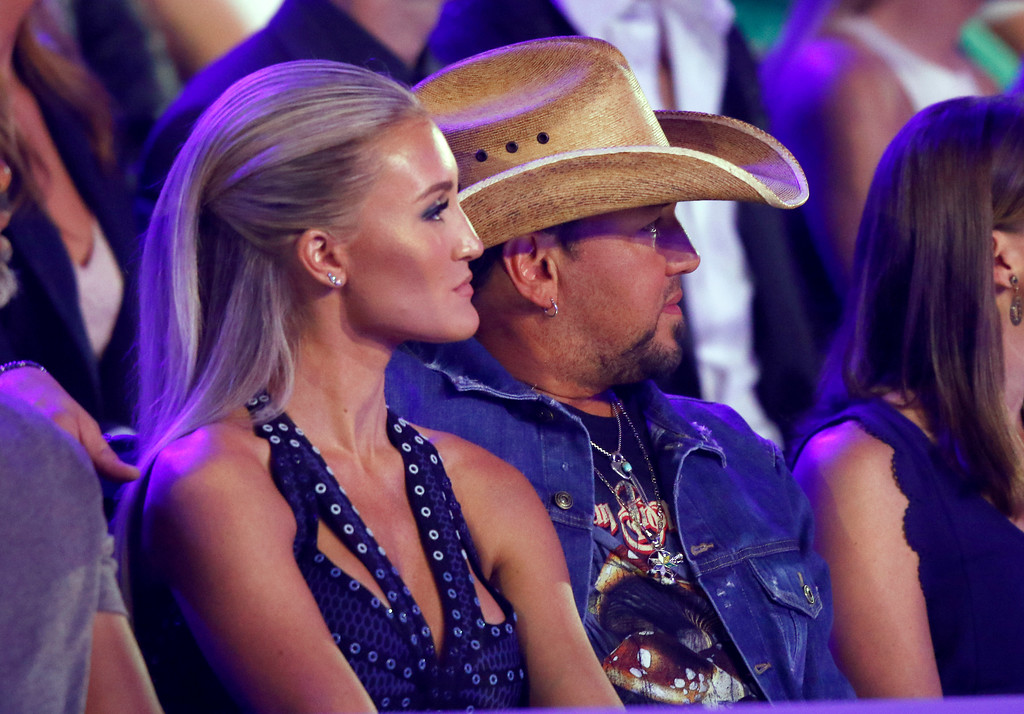 . Brittany Kerr, left, and Jason Aldean appear in the audience at the CMT Music Awards at Music City Center on Wednesday, June 7, 2017, in Nashville, Tenn. (Photo by Wade Payne/Invision/AP)