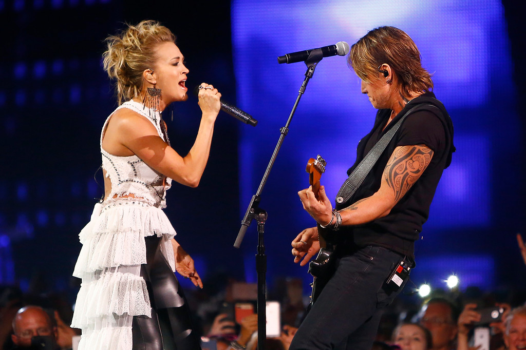 ". Carrie Underwood, left, and Keith Urban perform ""The Fighter\"" at the CMT Music Awards at Music City Center on Wednesday, June 7, 2017, in Nashville, Tenn. (Photo by Wade Payne/Invision/AP)"