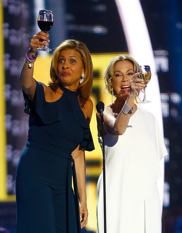 . Hoda Kotb, left, and Kathie Lee Gifford give a toast as they present the award for CMT performance of the year at the CMT Music Awards at Music City Center on Wednesday, June 7, 2017, in Nashville, Tenn. (Photo by Wade Payne/Invision/AP)