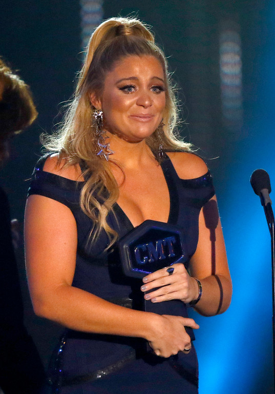". Lauren Alaina accepts the award for breakthrough video of the year for ""Road Less Traveled\"" at the CMT Music Awards at Music City Center on Wednesday, June 7, 2017, in Nashville, Tenn. (Photo by Wade Payne/Invision/AP)"