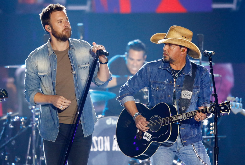 ". Charles Kelley, left, and Jason Aldean perform ""Midnight Rider\"" during a tribute to Greg Allman at the CMT Music Awards at Music City Center on Wednesday, June 7, 2017, in Nashville, Tenn. (Photo by Wade Payne/Invision/AP)"