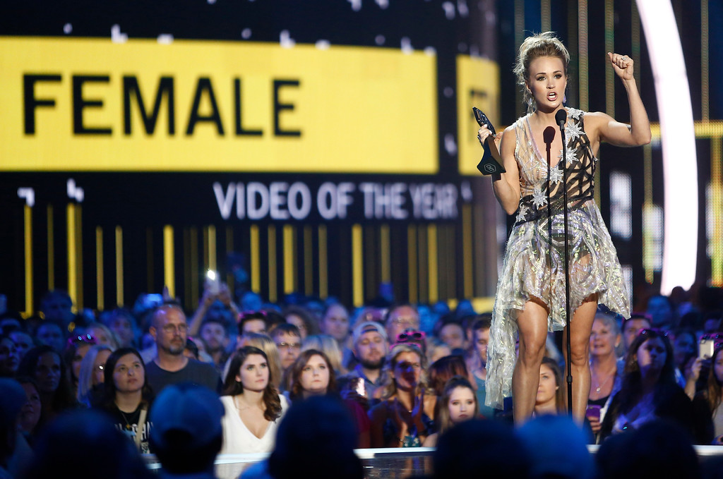 ". Carrie Underwood accepts the award for female video of the year for ""Church Bells\"" at the CMT Music Awards at Music City Center on Wednesday, June 7, 2017, in Nashville, Tenn. (Photo by Wade Payne/Invision/AP)"