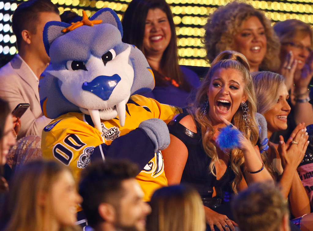 . Lauren Alaina sits in the audience with Gnash, the mascot for the NHL\'s Nashville Predators, at the CMT Music Awards at Music City Center on Wednesday, June 7, 2017, in Nashville, Tenn. (Photo by Wade Payne/Invision/AP)