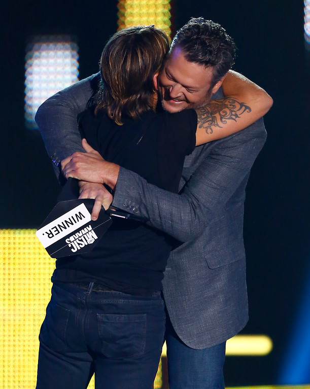. Blake Shelton, right, embraces Keith Urban as Shelton presents Urban with the award for CMT social superstar of the year at the CMT Music Awards at Music City Center on Wednesday, June 7, 2017, in Nashville, Tenn. (Photo by Wade Payne/Invision/AP)