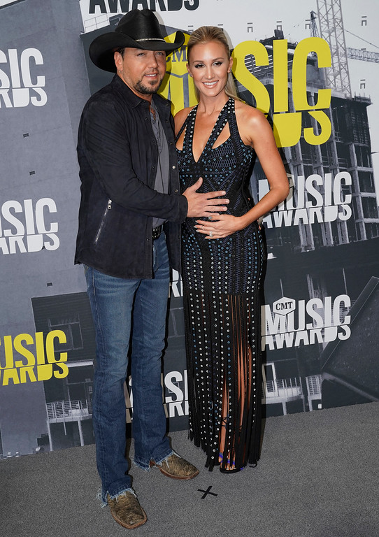 . Jason Aldean, left, and Brittany Kerr arrive at the CMT Music Awards at Music City Center on Wednesday, June 7, 2017, in Nashville, Tenn. (Photo by Sanford Myers/Invision/AP)