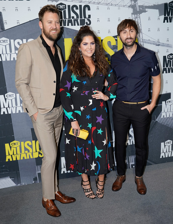 . Charles Kelley, from left, Hillary Scott, and Dave Haywood, of Lady Antebellum, arrive at the CMT Music Awards at Music City Center on Wednesday, June 7, 2017, in Nashville, Tenn. (Photo by Sanford Myers/Invision/AP)