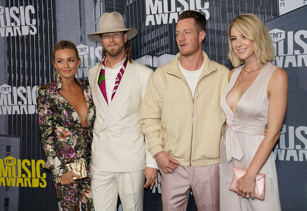 . Brittney Marie Cole, from left, Brian Kelley and Tyler Hubbard of Florida Georgia Line, and Hayley Hubbard arrive at the CMT Music Awards at Music City Center on Wednesday, June 7, 2017, in Nashville, Tenn. (Photo by Sanford Myers/Invision/AP)