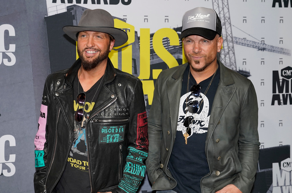 . Preston Brust, left, and Chris Lucas, of LoCash, arrive at the CMT Music Awards at Music City Center on Wednesday, June 7, 2017, in Nashville, Tenn. (Photo by Sanford Myers/Invision/AP)