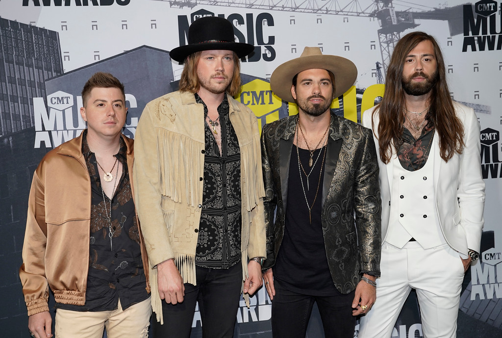 . Bill Satcher, Michael Hobby, Zach Brown and Graham DeLoach of A Thousand Horses arrive at the CMT Music Awards at Music City Center on Wednesday, June 7, 2017, in Nashville, Tenn. (Photo by Sanford Myers/Invision/AP)