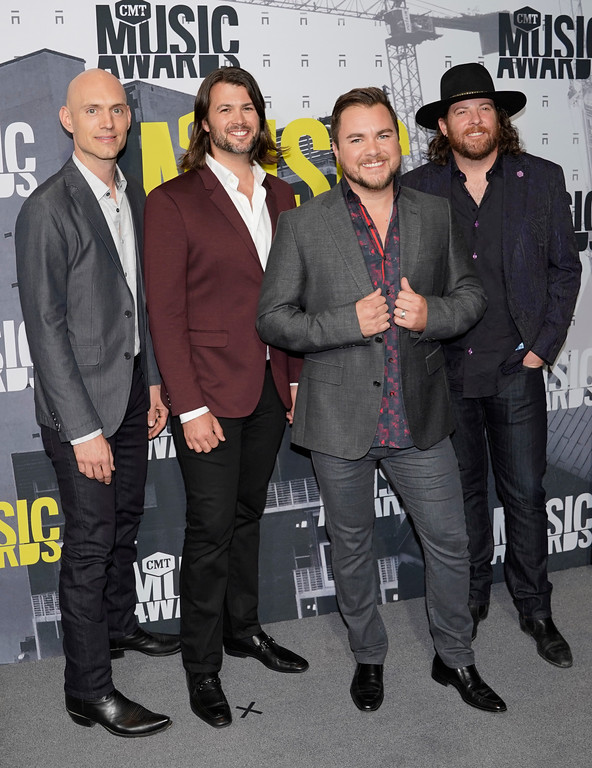 . Jon Jones, from left, James Young, Mike Eli and Chris Thompson, of Eli Young Band arrive at the CMT Music Awards at Music City Center on Wednesday, June 7, 2017, in Nashville, Tenn. (Photo by Sanford Myers/Invision/AP)