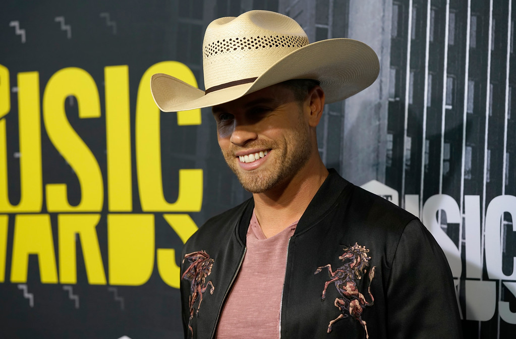 . Dustin Lynch arrives at the CMT Music Awards at Music City Center on Wednesday, June 7, 2017, in Nashville, Tenn. (Photo by Sanford Myers/Invision/AP)