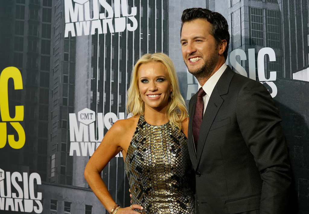 . Caroline Boyer, left, and Luke Bryan arrive at the CMT Music Awards at Music City Center on Wednesday, June 7, 2017, in Nashville, Tenn. (Photo by Sanford Myers/Invision/AP)