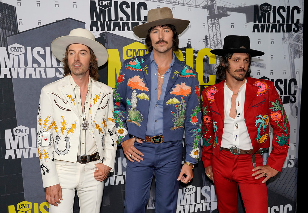 . Jess Carson, from left, Mark Wystrach, Cameron Duddy, of Midland, arrive at the CMT Music Awards at Music City Center on Wednesday, June 7, 2017, in Nashville, Tenn. (Photo by Sanford Myers/Invision/AP)