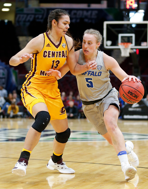 . Buffalo guard Katherine Ups, right, drives against Central Michigan forward Reyna Frost during the first half of an NCAA college basketball game in the championship of the Mid-American Conference tournament Saturday, March 10, 2018, in Cleveland. (AP Photo/Ron Schwane)