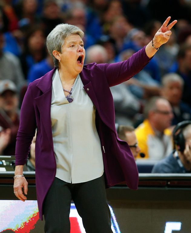 . Central Michigan head coach Sue Guevara signals to her team during the first half of an NCAA college basketball game in the championship of the Mid-American Conference tournament Saturday, March 10, 2018, in Cleveland. Central Michigan won 96-91. (AP Photo/Ron Schwane)