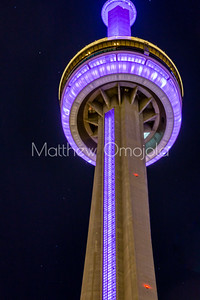Close up of the viewing platform and restaurant CN Tower Toronto Canada at night with purple lighting