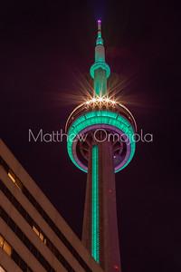 Top of CN tower at night green lighting.