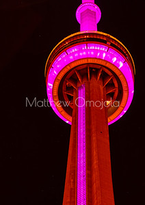 Close up CN Tower Toronto Canada at night with pink lighting