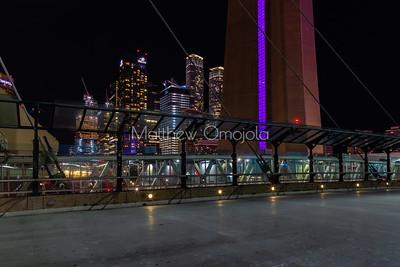 Walkway around CN tower at night with Toronto high rises