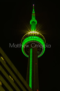 Top of CN Tower Toronto Canada at night with green lighting